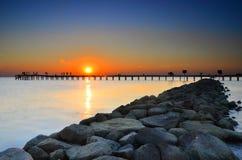 Заход солнца и пристань Стоковое Фото