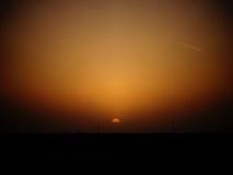 Заход солнца и реактивная струя Стоковая Фотография RF