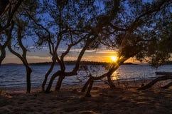 Заход солнца как увидено от песчаного пляжа Стоковая Фотография RF