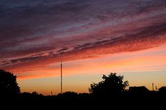 Заход солнца красное небо Стоковые Изображения RF