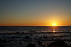 Заход солнца морем Стоковые Изображения RF
