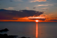 Заход солнца морем Стоковая Фотография