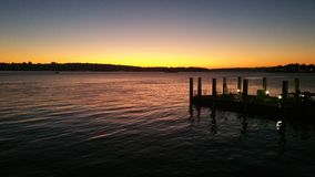 Заход солнца, море, порт гавани, круговая набережная стоковое фото rf