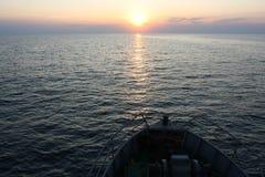Заход солнца 2 моря стоковые фото