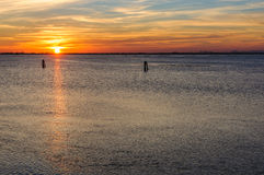 Заход солнца на лагуне около Chioggia, Италии Стоковая Фотография