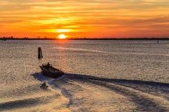 Заход солнца на лагуне около Chioggia, Италии Стоковые Изображения