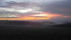Заход солнца на ландшафте Стоковые Фото