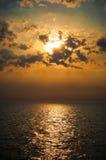 Заход солнца над морем Стоковая Фотография