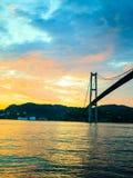 Заход солнца над висячим мостом в Бергене, Норвегии Стоковое Изображение RF