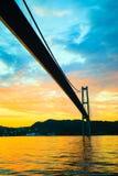 Заход солнца над висячим мостом в Бергене, Норвегии Стоковое Фото