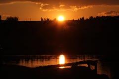 Заход солнца на воде Стоковые Изображения RF
