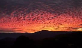 Заход солнца над горами Стоковые Фото