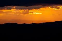 Заход солнца над горами Стоковая Фотография