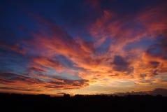 Заход солнца на городе Стоковые Изображения