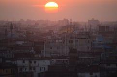 Заход солнца над Даккой, Бангладешем Стоковое Изображение