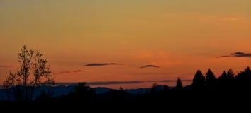 Заход солнца над землей Стоковые Фотографии RF