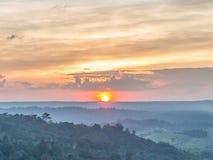 Заход солнца над зелеными горами Стоковое фото RF