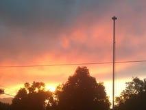 Заход солнца на линиях электропередач Стоковые Изображения RF
