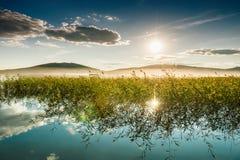 Заход солнца на красивом озере Стоковое Фото