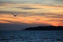 Заход солнца на кристаллическом пляже Стоковые Фотографии RF