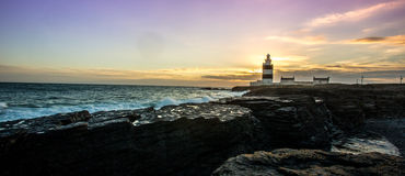 Заход солнца на маяке крюка Стоковая Фотография RF