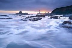 Заход солнца на маяке пункта Pegoin Стоковое Изображение