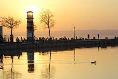 Заход солнца над маяком Стоковая Фотография