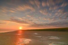 Заход солнца на малой воде Стоковые Изображения RF