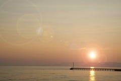 Заход солнца над морем Стоковые Изображения RF
