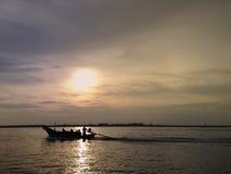 Заход солнца на море выравниваясь тихо Стоковые Фотографии RF