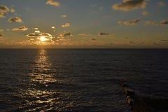 Заход солнца на море в зиме Стоковая Фотография