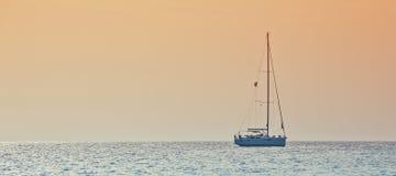 Заход солнца на море Стоковое Изображение