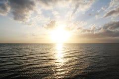 Заход солнца на море Стоковое Фото