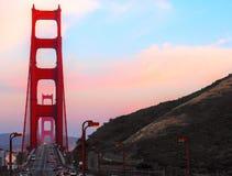 Заход солнца над мостом золотого строба Сан-Франциско стоковое фото rf