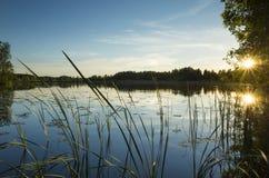 Заход солнца на озере в Швеции Стоковое Фото