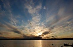 Заход солнца на озере с сценарными облаками Стоковое фото RF