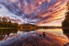Заход солнца на озере Стоковые Изображения