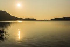 Заход солнца на озере Стоковое Фото