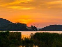 Заход солнца на озере Стоковые Фото