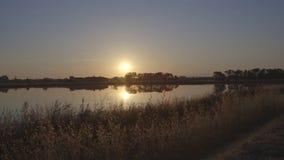 Заход солнца над озером сток-видео