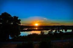 Заход солнца над озером Стоковая Фотография RF