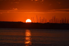 Заход солнца на доке Стоковые Изображения