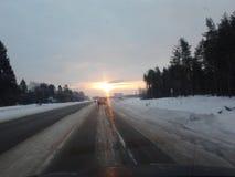 Заход солнца на дороге Стоковая Фотография