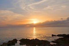 Заход солнца на острове Grand Cayman, Каймановых островах Стоковая Фотография