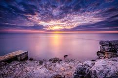 Заход солнца на открытом море Стоковые Изображения RF