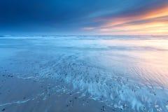 Заход солнца над побережьем Северного моря Стоковое Изображение