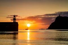 Заход солнца на порте Erin в острове Мэн Стоковая Фотография RF