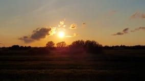 Заход солнца на поле мозоли Состав природы Стоковые Фото