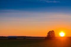 Заход солнца на полях Стоковое Фото