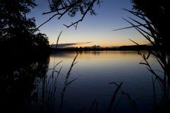 Заход солнца над прудом Стоковая Фотография